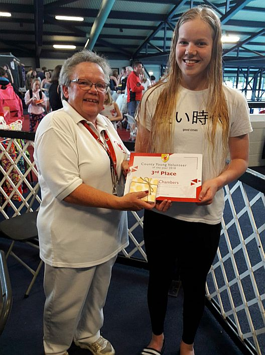 Fiona Bowen presents award to Young Volunteer Katie Chambers